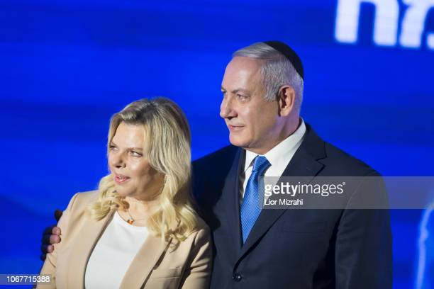 Israeli Prime Minister Benjamin Netanyahu stands by his wife Sara before lighting a stylisedmenorah during the start of Hanukkah the Jewish festival...