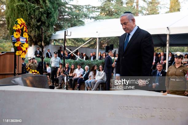 Israeli Prime Minister Benjamin Netanyahu stands in front of the grave of former Israeli prime minister Yitzhak Rabin during a state memorial...