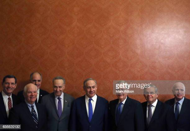 Israeli Prime Minister Benjamin Netanyahu stands with members of the US Senate John Barrasso Ben Cardin Robert Casey Senate Minority Leader Chuck...