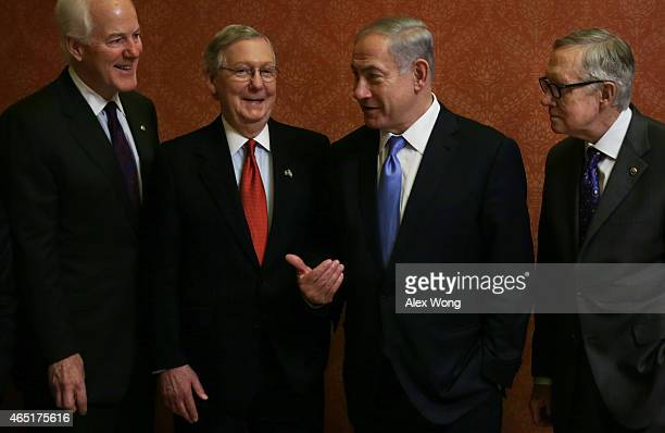 Israeli Prime Minister Benjamin Netanyahu talks to US Senate Majority Leader Sen Mitch McConnell and Senate Majority Whip Sen John Cornyn as Senate...
