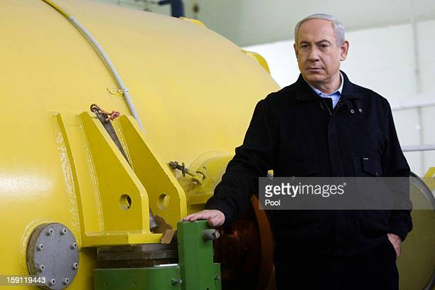 Israeli Prime Minister Benjamin Netanyahu visits the electronic accelerator lab in the Ariel University Center January 8 2013 in Ariel West Bank The...