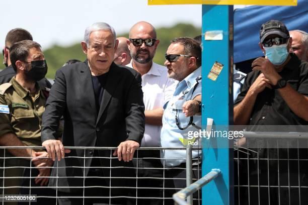 Israeli Prime Minister Benjamin Netanyahu visits the scene where dozens were killed in crush at a religious festival in Mount Meron on April 30, 2021...
