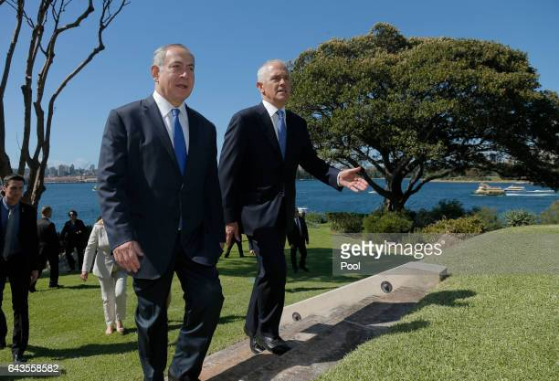 Israeli Prime Minister Benjamin Netanyahu walks with Australian Prime Minister Malcolm Turnbull upon their arrival at Admiralty House on February 22...