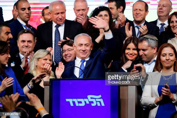 TOPSHOT Israeli Prime Minister Benjamin Netanyahu waves to supporters at his Likud Party headquarters in the Israeli coastal city of Tel Aviv on...