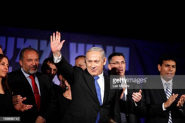 Israeli Prime Minister Benjamin Netanyahu waves to supporters at his election campaign headquarters on Janurary 23 2013 in Tel Aviv Israel Netanyahu...