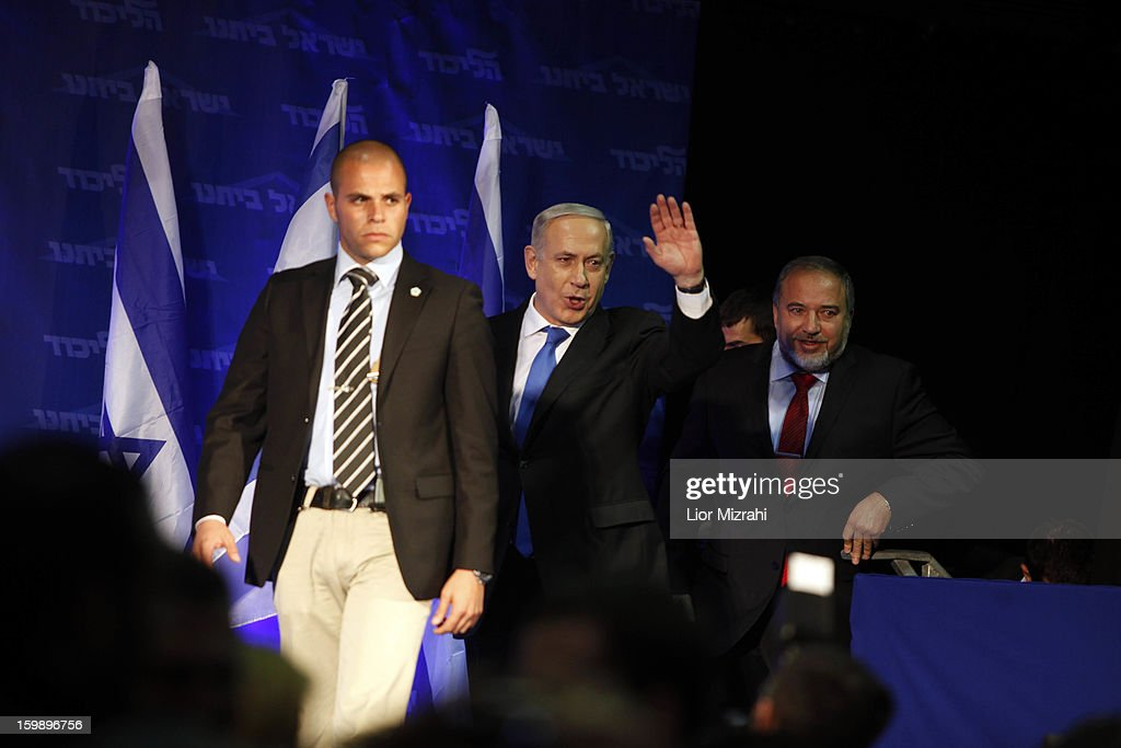 Israeli Prime Minister Benjamin Netanyahu waves to supporters at his election campaign headquarters on Janurary 23, 2013 in Tel Aviv, Israel. Netanyahu was re-elected for a third term and will return to office, according to exit polls. Israel had the highest turnout of voters since 1999.