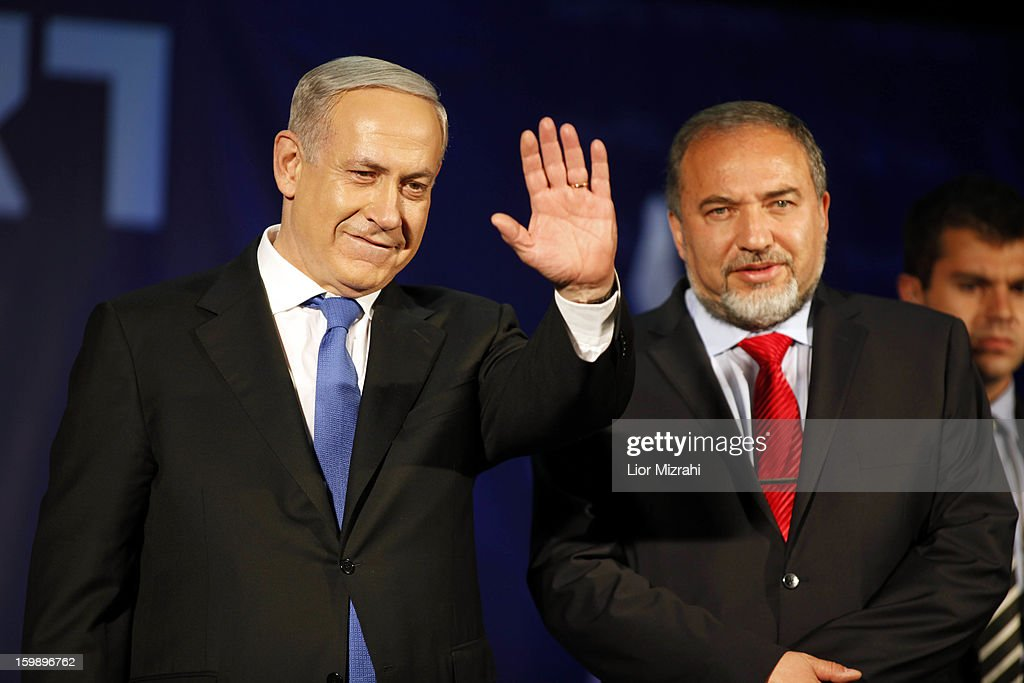 Israeli Prime Minister Benjamin Netanyahu waves to supporters with Former Israel Minister for Foreign Affairs Avigdor Liberman at his election campaign headquarters on Janurary 23, 2013 in Tel Aviv, Israel. Netanyahu was re-elected for a third term and will return to office, according to exit polls. Israel had the highest turnout of voters since 1999.