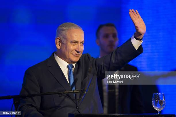 Israeli Prime Minister Benjamin Netanyahu waves while delivering a speech before lighting a stylisedmenorah during the start of Hanukkah the Jewish...