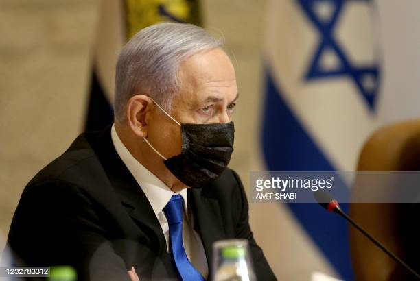 Israeli Prime Minister Benjamin Netanyahu, wearing a mask for protection against the COVID-19 pandemic, attends a special cabinet meeting on the...