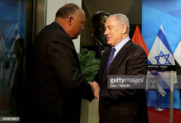 Israeli Prime Minister Benjamin Netanyahu welcomes Egyptian Foreign Minister Sameh Shoukry prior to their meeting at his Jerusalem office on July 10...