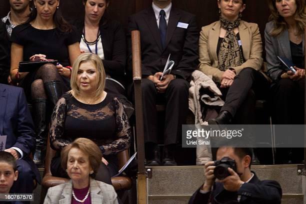 Israeli Prime Minister Benjamin Netanyahu's wife Sara Netanyahu attends the swearingin ceremony of the 19th Knesset the new Israeli parliament on...
