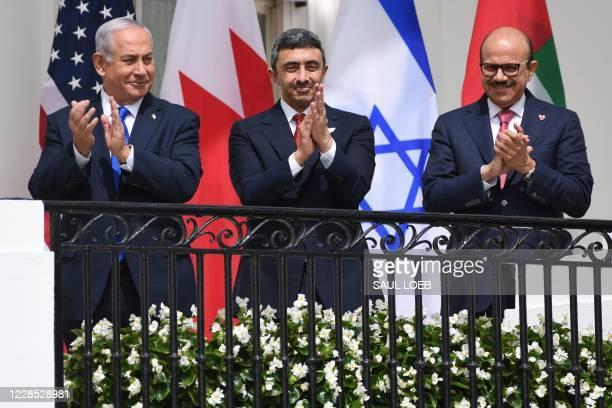 Israeli Prime Minister Benjamin Netanyahu,UAE Foreign Minister Abdullah bin Zayed Al-Nahyan and Bahrain Foreign Minister Abdullatif al-Zayani applaud...