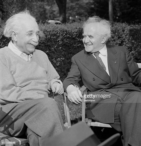 Israeli Prime Minister David BenGurion chats intimately with Professor Albert Einstein at the professor's home in Princeton today BenGurion visited...