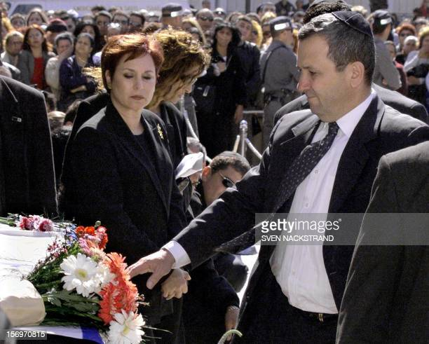 Israeli Prime Minister Ehud Barak accompanied by his wife Nava touches coffin of Israeli singer Ofra Haza during a prefuneral ceremony in Tel Aviv 24...