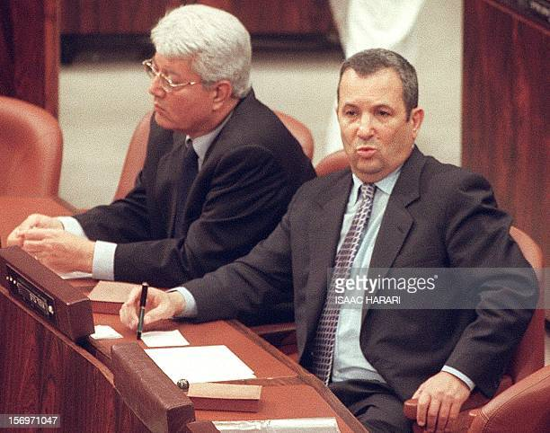 Israeli Prime Minister Ehud Barak and Foreign Minister David Levy attend a special parliamentary session at the Knesset in Jerusalem 10 July 2000 The...