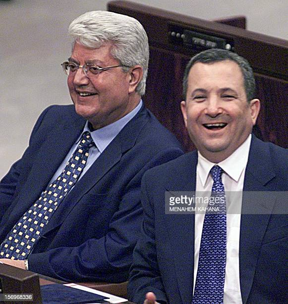 Israeli Prime Minister Ehud Barak and Foreign Minister David Levy laugh in their new seats after the swearing in ceremony of the new government in...