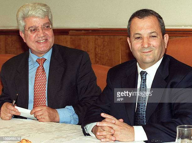 Israeli Prime Minister Ehud Barak and Foreign Minister David Levy smile before an extraordinary meeting of the Israeli cabinet 03 September 199 in...