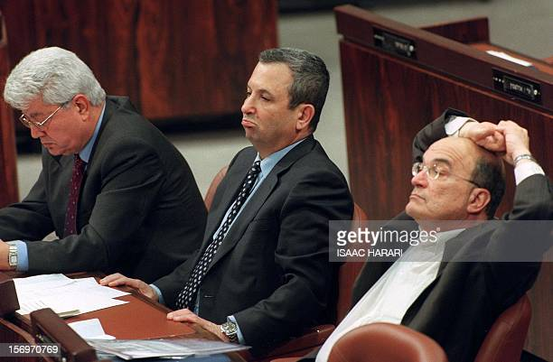 Israeli Prime Minister Ehud Barak Education Minister Yossi Sarid and Foreign Minister David Levy attend a session at the Knesset in Jerusalem 07...