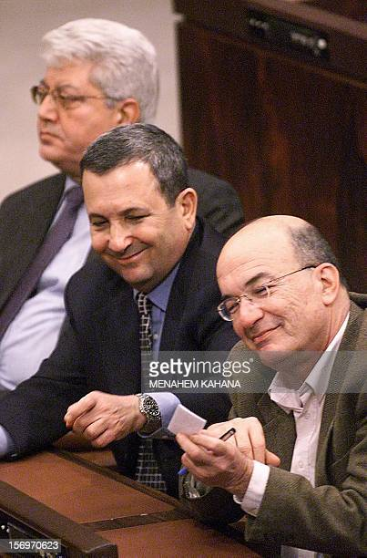 Israeli Prime Minister Ehud Barak Foreign Minister David Levy and Education Minister Yossi Sarid attend a Knesset session in Jerusalem 13 December...