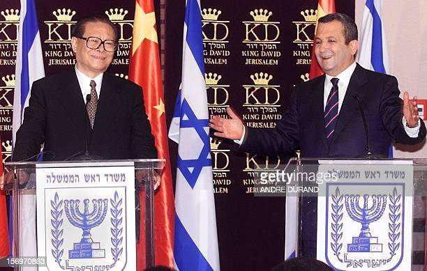 Israeli Prime Minister Ehud Barak gestures during a press conference with Chinese President Jiang Zemin 13 April 2000 at a central Jerusalem hotel....