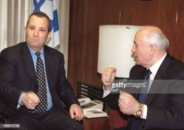 Israeli Prime Minister Ehud Barak gestures with former Russian president and current Green Cross President Mikhael Gorbachev 01 March 2000 in...