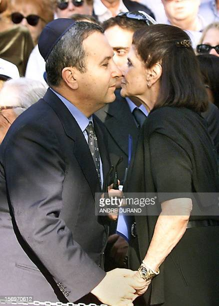 Israeli Prime Minister Ehud Barak kisses Leah Rabin, widow of the late Israeli Prime Minister Yitzhak Rabin 04 November 1999 during the memorial...