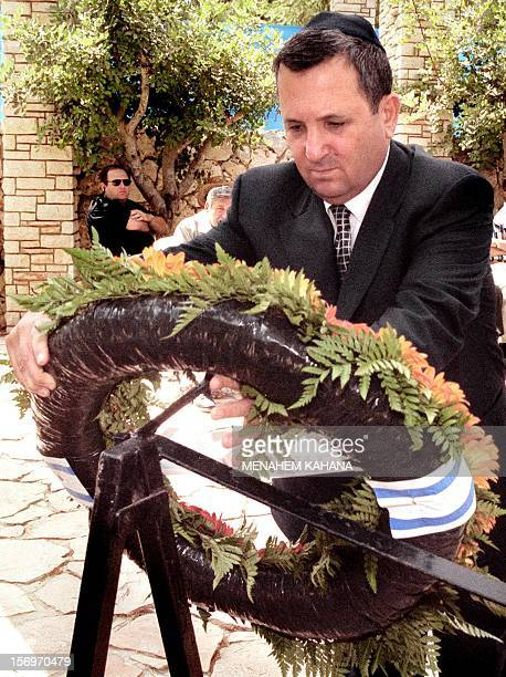 Israeli Prime Minister Ehud Barak lays a wreath 21 September 1999 at a memorial ceremony for 2,609 Israeli soldiers killed during the 1973...