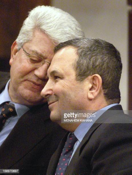 Israeli Prime Minister Ehud Barak listens to his Foriegn Minister David Levy 24 January 2000 at the Knesset in Jerusalem during a special session...