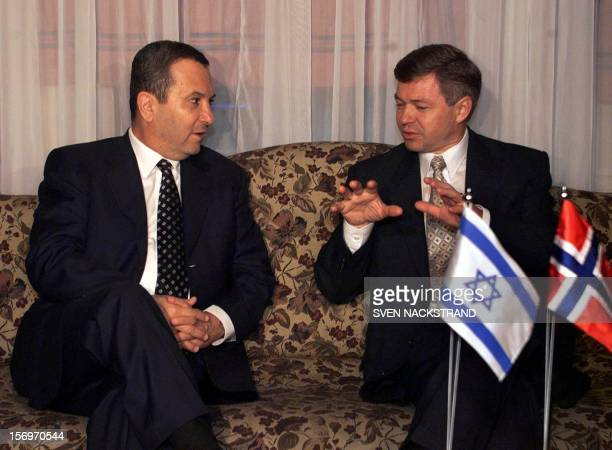 Israeli Prime Minister Ehud Barak listens to his Norwegian host and counterpart Kjell Magne Bondvik at the begining of their breakfast meeting in...