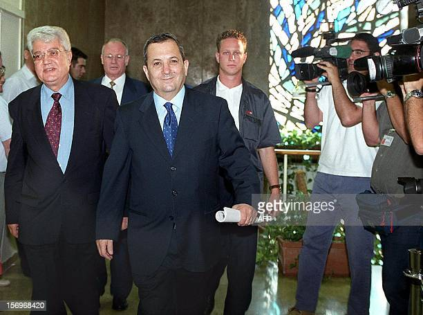 Israeli Prime Minister Ehud Barak smiles as he and foreign minister David Levy enter the first cabinet meeting of Barak's new coalition government 11...
