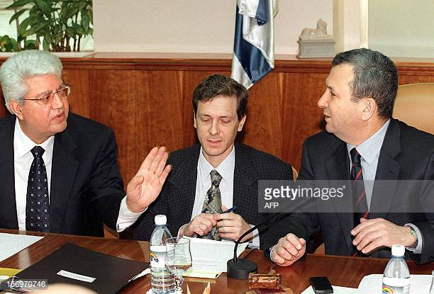 Israeli Prime Minister Ehud Barak talks to his Foreign Minister David Levy during the weekly cabinet meeting in Jerusalem 27 February 2000 The...