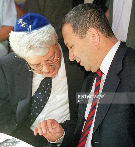 Israeli Prime Minister Ehud Barak talks with his Foreign Minister designate David Levy during the wedding of Levy's daughter Orly in Petah Tiqva 04...