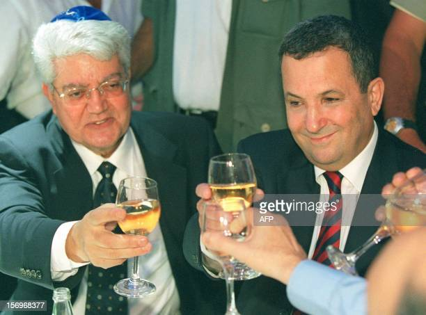 Israeli Prime Minister Ehud Barak toasts with his Foreign Minister designate David Levy and other guests during the wedding of Levy's daughter Orly...
