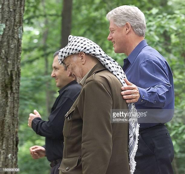 Israeli Prime Minister Ehud Barak US President Bill Clinton and Palestinian leader Yasser Arafat walk towards Laurel Cabin the site where former...