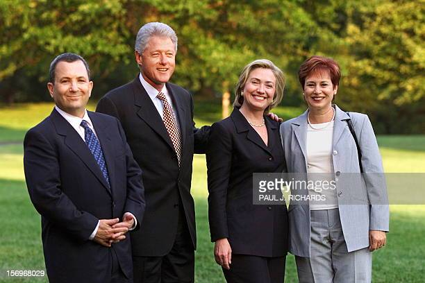 Israeli Prime Minister Ehud Barak US President Bill Clinton US First Lady Hillary Clinton and Mrs Nave Barak pose for a photo 15 July on the South...