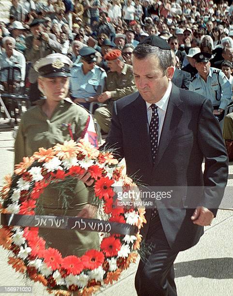 Israeli Prime Minister Ehud Barak walks to lay a wreath during the official state ceremony at the Yad Vashem holocaust memorial in Jerusalem 02 May...