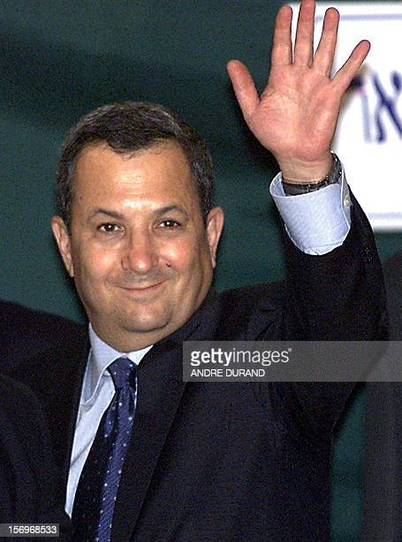 Israeli Prime Minister Ehud Barak waves to the press on his way to a working meeting with Palestinian Authority President Yasser Arafat the Erez...