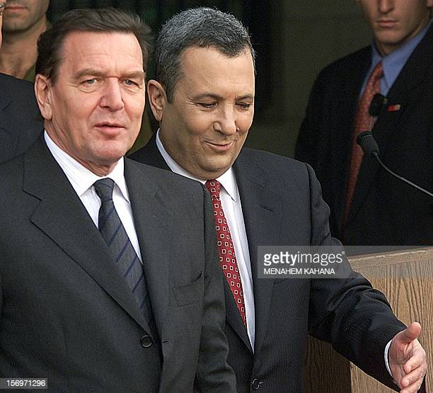 Israeli Prime Minister Ehud Barak welcomes German Chancellor Gerhard Schroeder during a welcoming ceremony at the prime minister's office in...