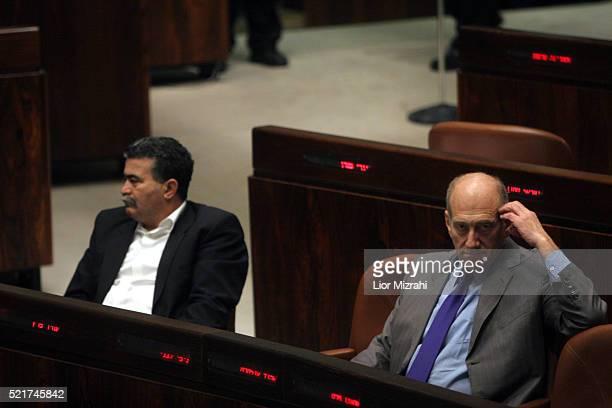 Israeli Prime Minister Ehud Olmert and Defence Minister Amir Peretz sit at the Knesset during an Economic Arrangements Law vote in Jerusalem on...