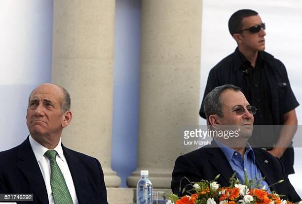 Israeli Prime Minister Ehud Olmert and Defence Minister Ehud Barak are seen during a ceremony on July 31, 2007 in Jerusalem, Israel.