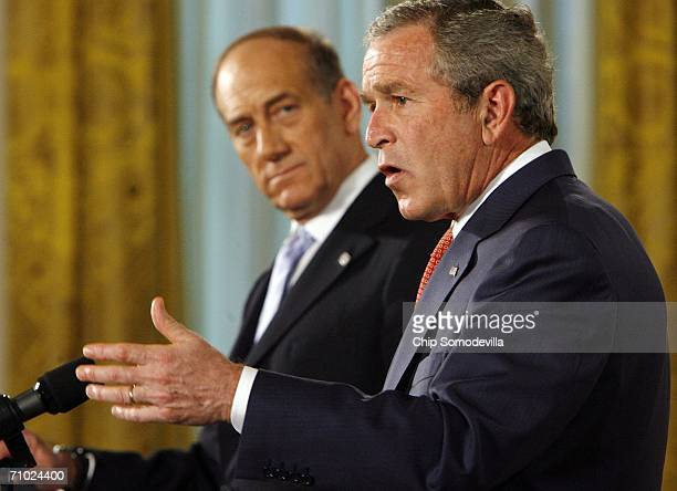 Israeli Prime Minister Ehud Olmert and US President George W Bush hold a news conference in the East Room of the White House May 23 2006 in...