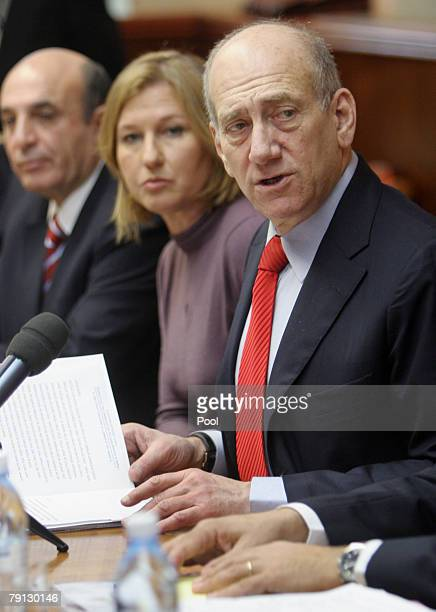 Israeli Prime Minister Ehud Olmert chairs the weekly cabinet meeting in his Jerusalem offices on January 20, 2008 in Jerusalem, Israel. Next to...