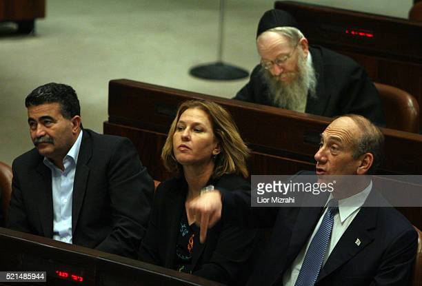 Israeli Prime Minister Ehud Olmert Foreign Minister Tzipi Livni and Defence Minister Amir Peretz during a budget vote in the Knesset, Israel's...