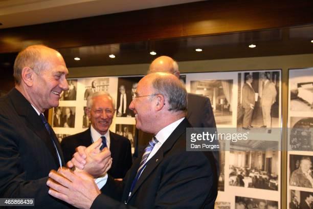 Israeli Prime Minister Ehud Olmert greet former Governor of the Bank of Israel Professor Jacob Frenkel as fellow former Governor of the Bank of...