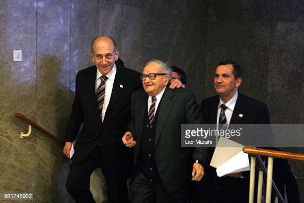 Israeli Prime Minister Ehud Olmert left and Pensioners Minister Rafi Eitan arrive to the weekly cabinet meeting in Jerusalem Sunday February 11 2006...