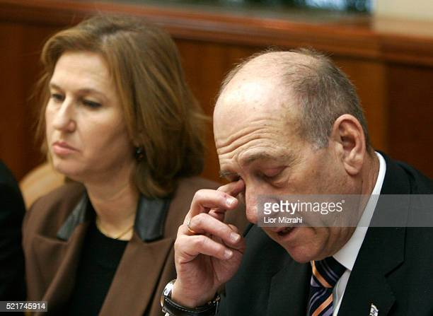 Israeli Prime Minister Ehud Olmert, right, and Foreign Minister Tzipi Livni attend the weekly cabinet meeting in Jerusalem, Sunday, February 11,...