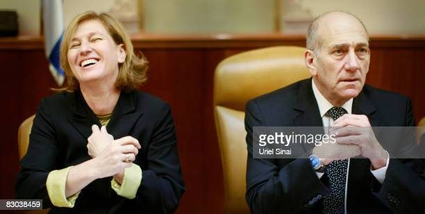 Israeli Prime Minister Ehud Olmert sits next to foreign minister Tzipi Livni at the weekly cabinet meeting on September 28, 2008 in Jerusalem,...