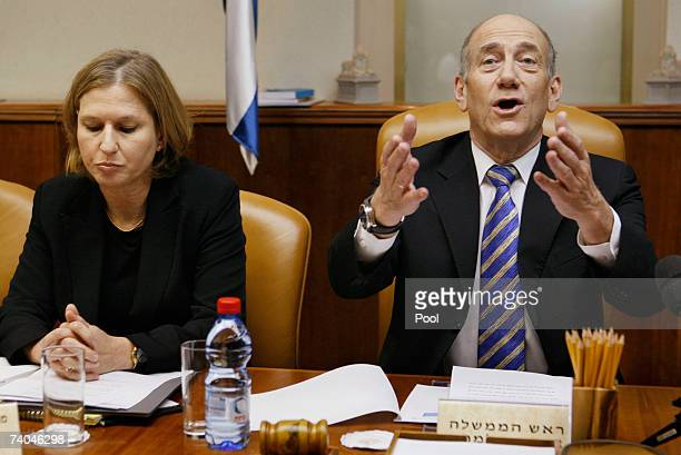 Israeli Prime Minister Ehud Olmert speaks as Foreign Minister Tzipi Livni looks on at a special meeting of the cabinet at his office on May 2, 2007...