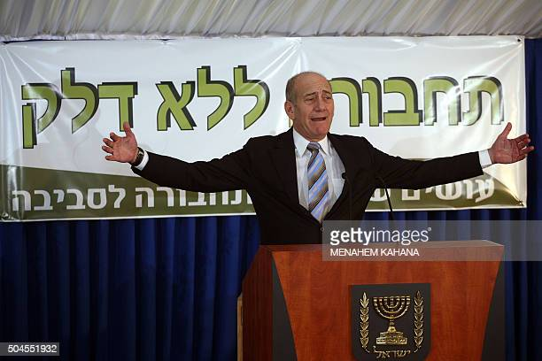 Israeli Prime Minister Ehud Olmert stands in front of a banner reading in Hebrew transportation without fuel during a ceremony in which Israeli...