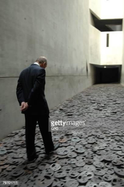 Israeli Prime Minister Ehud Olmert visits the holocaust memorial by artist Menashe Kadishman on February 11, 2008 in the Jewish museum in Berlin,...
